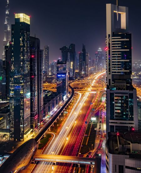 #dubai, dubai, sheikh zayed Dubai Sheikh Zayed Road Longexposurephotography Nightphotography Dubai❤ Burj Khalifa Towers And Sky Lighttrails Overpass Elevated Road Tail Light Headlight Highway Multiple Lane Highway Traffic Light Trail Road Intersection Traffic Jam