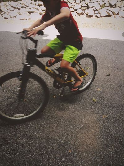 Wheelie on a bike Kid Bike Wheelie Bicycle Transportation Real People One Person Full Length Lifestyles Leisure Activity Cycling Outdoors Ride Men Sport Mode Of Transportation Riding