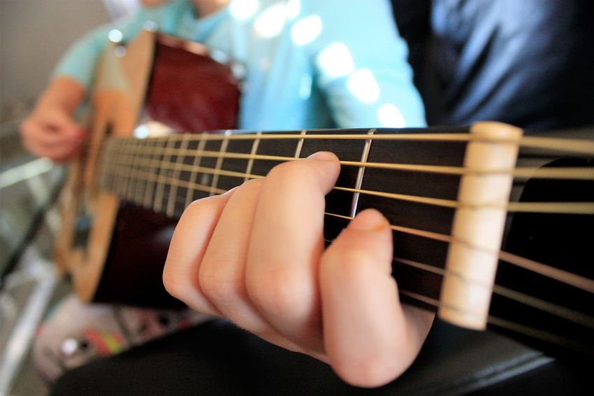 Music moves me Arts Culture And Entertainment Close-up Fretboard Guitar Guitarist Human Hand Leisure Activity Lifestyles Music Musical Instrument Musical Instrument String One Person Playing Plucking An Instrument Real People Young Adult