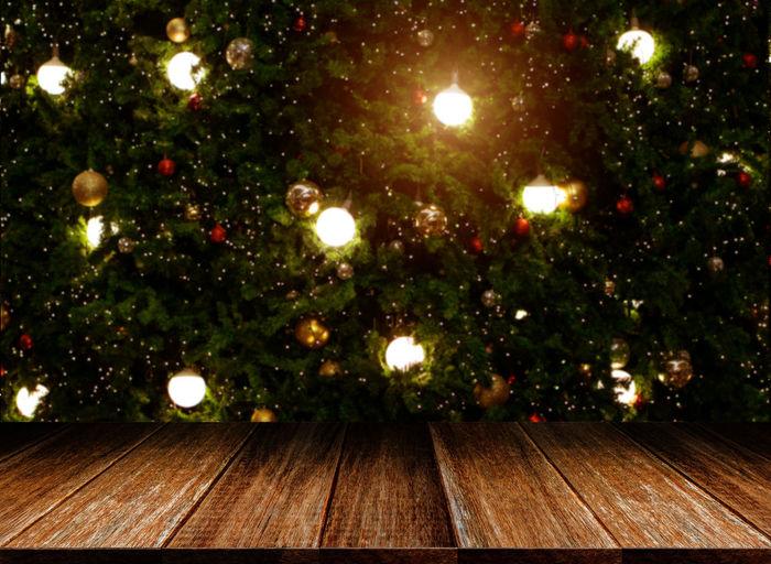Illuminated christmas lights on tree at night