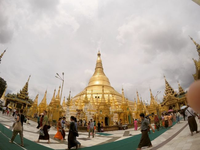 Doing good deeds at Shwedagon Pagoda. People And Places