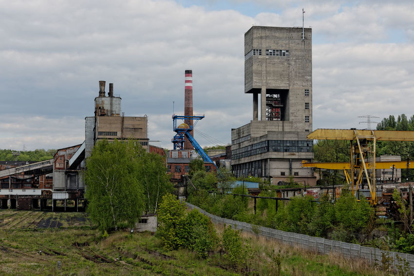 An old coal mine in Poland. Coal Mine Poland Architecture Building Building Exterior Built Structure City Cloud - Sky Day Factory Fuel And Power Generation History Industrial Building  Industrial Equipment Industry Nature No People Old Old Coal Mine Outdoors Plant Sky The Past Tower Transportation