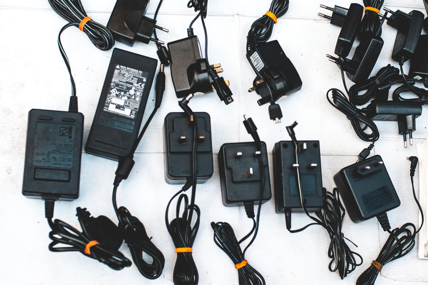 Black Color Cable Camera - Photographic Equipment Communication Connection Day High Angle View Indoors  Large Group Of Objects No People Portable Information Device Still Life Technology Telephone White Background Wireless Technology