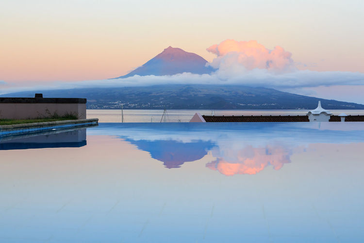 Scenic view of swimming pool against sky during sunset