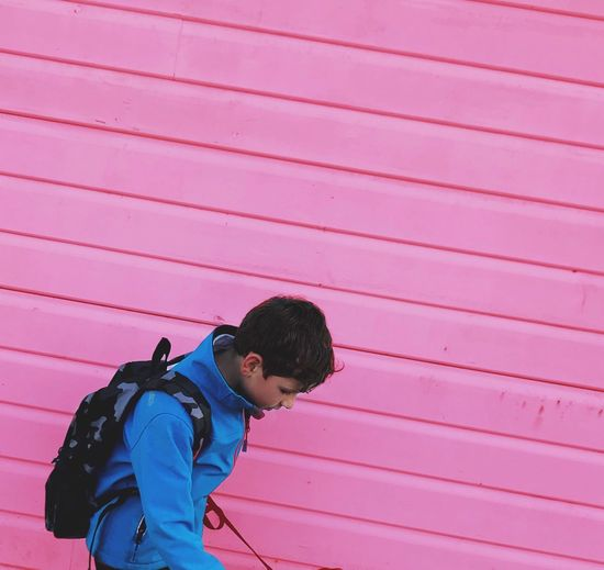 It's S Boys Life In A Pink World Pink Color Childhood Outdoors One Person Pink Contrast Lines Diagonal Lines Contrasting Colors Masculine And Feminine Boy Against A Background Copy Space Visual Creativity 17.62°