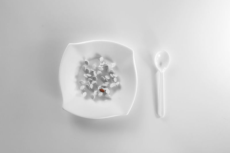 High angle view of ice cream on white table