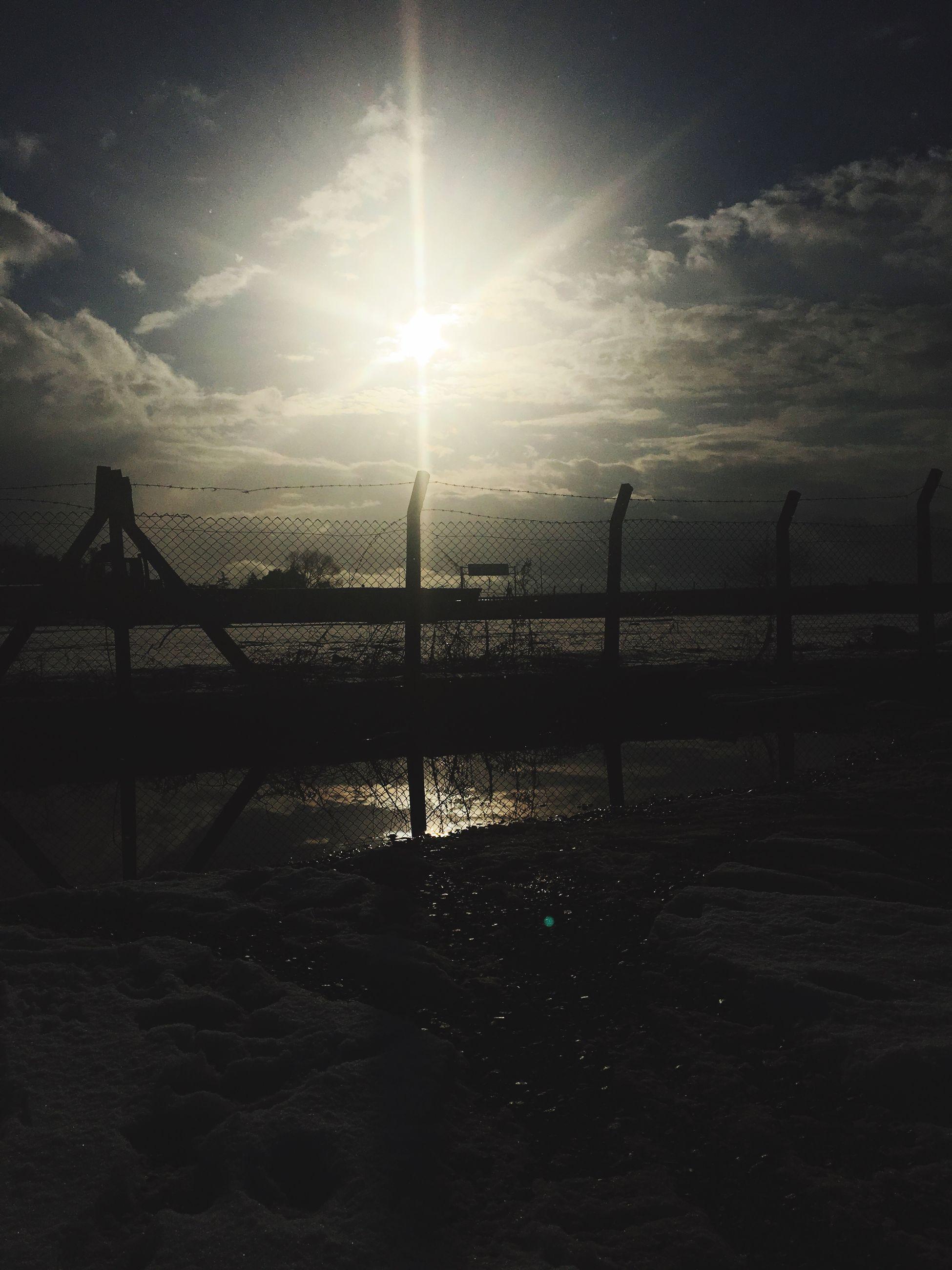 sky, sunlight, sun, sunset, nature, sunbeam, silhouette, sea, water, outdoors, no people, beauty in nature, bridge - man made structure, scenics, day