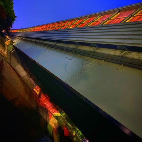 Low angle view of multi colored building against sky