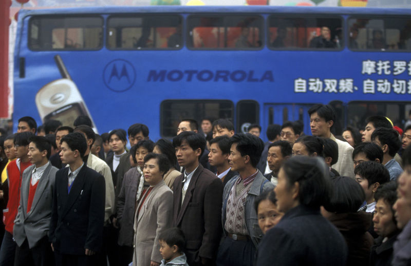 Commuters Waiting For Bus On Street