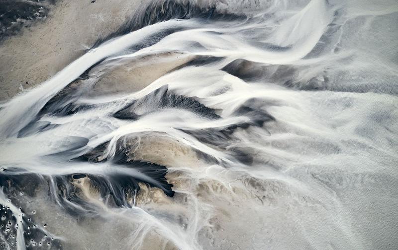 Blurred motion of rocks in sea