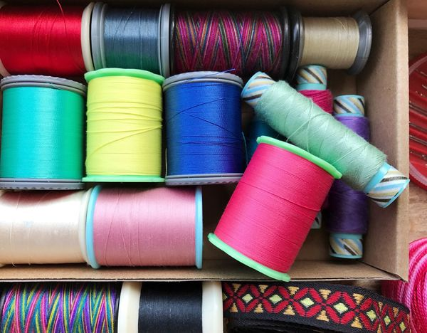 Sewing tools Spool Multi Colored Sewing Item Cotton Rolled Up Variation Textile Stack Textile Industry Craft Vibrant Color Handmade Needlework Tools Ribon Collection Box Purple No People Arrangement Green Color Sewing Choice Indoors  Close-up