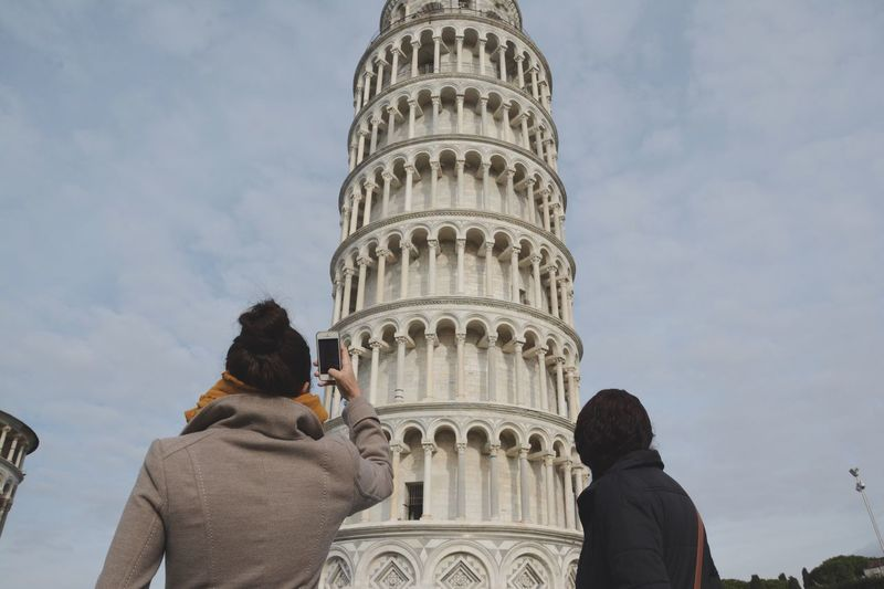 Rear View Of Women Against Leaning Tower Of Pisa