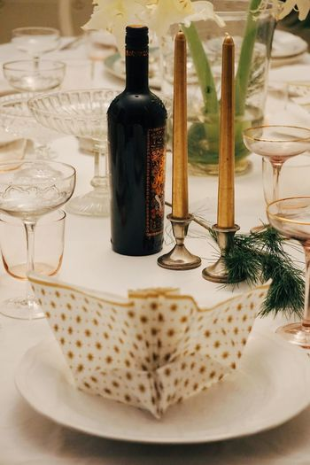 High angle view of napkin in plate with wineglasses on table