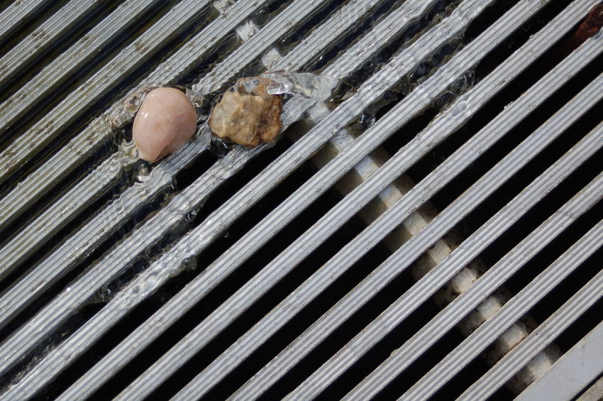 Backgrounds Day Design Drain Full Frame Lines Metal Nature No People Pattern Pebbles Sewer Stones Urban Geometry Water