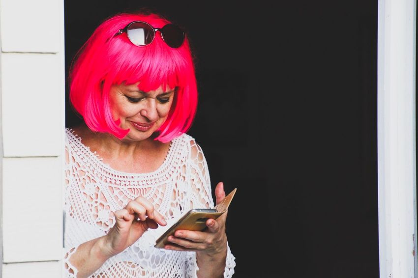 Woman in pink wig and sunglasses using a mobile phone Communication Holding Lifestyles Wireless Technology Real People One Person Technology Indoors  People Adult Wig Pink Wig Mobile Phone Mobile Devices Woman Portrait My Year My View Uniqueness Women Around The World Millennial Pink Welcome To Black Be. Ready.