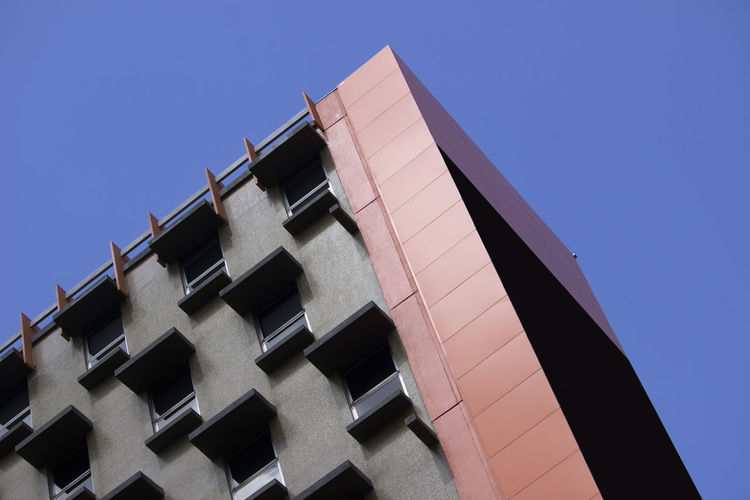 Pink Wall Architecture Blue Building Building Exterior Built Structure City Clear Sky Construction Industry Copy Space Day Location Low Angle View Modern Nature No People Outdoors Pattern Pink Color Place Residential District Sky Sunlight