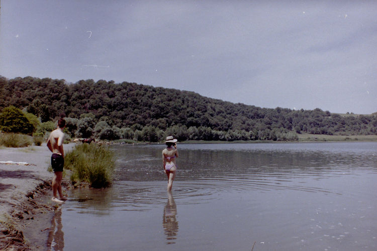 Analogue Photography Couple Summer Exploratorium Vacations Boy Girls Italian Lake Italy Lake Leisure Activity Nature Real People Shore Sky Summer Swimsuit Togetherness Two People Water Women