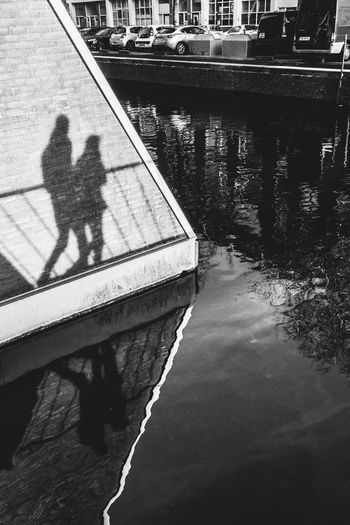 Shadow walkers Water Reflection Nature Day Architecture Built Structure High Angle View Men Two People Lifestyles Real People River Shadow Outdoors Transportation Waterfront Leisure Activity Togetherness Sunlight Streetphotography