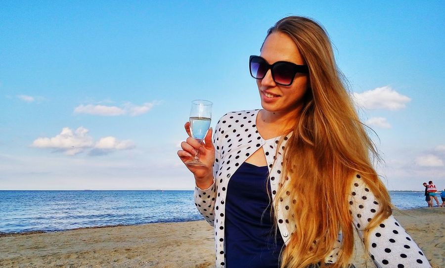 Wine at the baltic sea coast in poland Sunglasses Drinking Beach Sea Sky Drink Summer Refreshment Smiling Vacations Wine Wine Not Mix Yourself A Good Time