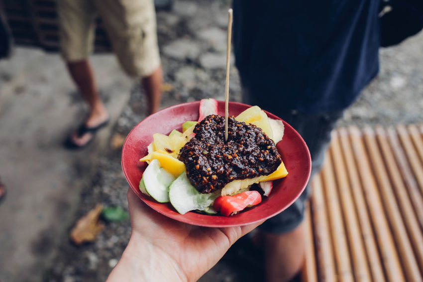 Ambon ASIA Cropped Focus On Foreground Food Food And Drink Freshness Fruit Salad Holding INDONESIA Lifestyles Maluku  Person Personal Perspective Ready-to-eat Rujak Sweet Food Traveling Unrecognizable Person Wanderlust