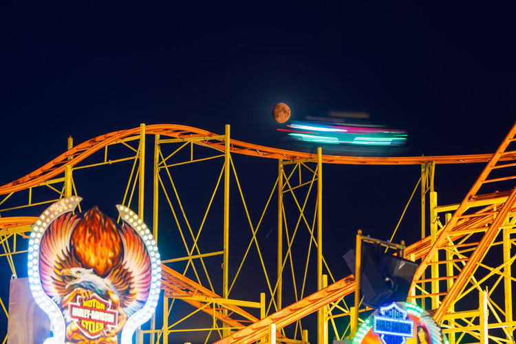 Hamburg, Hamburger Dom Amusement Park Amusement Park Ride Architecture Blurred Motion Clear Sky Enjoyment Excitement Fairground Ferris Wheel Illuminated Low Angle View Moon, Night No People Outdoors Positive Emotion Rollercoaster Sky Speed