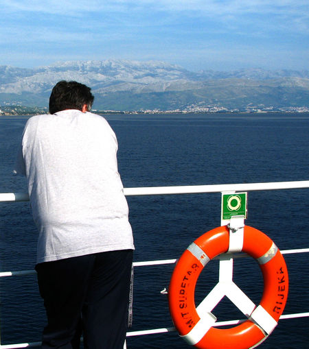 Beauty In Nature Croatian Coastal Voyage Day Ferry Passengers Horizon Over Water Life Belt Lifestyles Men Mountain Nature Nautical Vessel One Person Outdoors Real People Rear View Scenics Sea Sky Standing Water Website Design Breathing Space