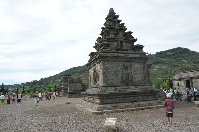 Travel Destinations Tourist Travel Place Of Worship Tourism Vacations Diengplateau Dieng WonosoboOld Ruin Candiarjuna Religion History Ancient Civilization Large Group Of People Architecture Ancient Real People Men Lifestyles Women Archaeology Adults Only Spirituality