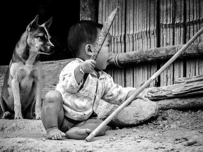 EyeEmNewHere Animal Themes Boys Childhood Cute Day Dog Domestic Animals Full Length Mammal One Animal One Person Outdoors People Pets Playing Real People Sitting