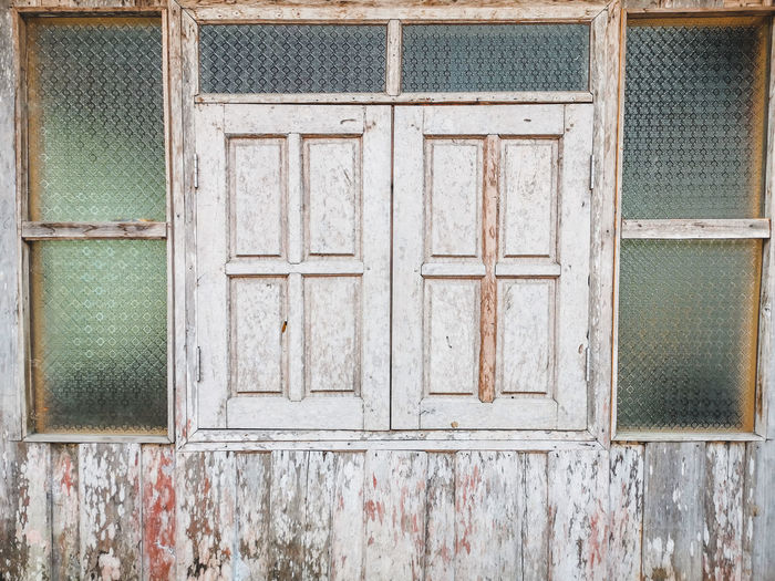Full frame shot of closed window of old building