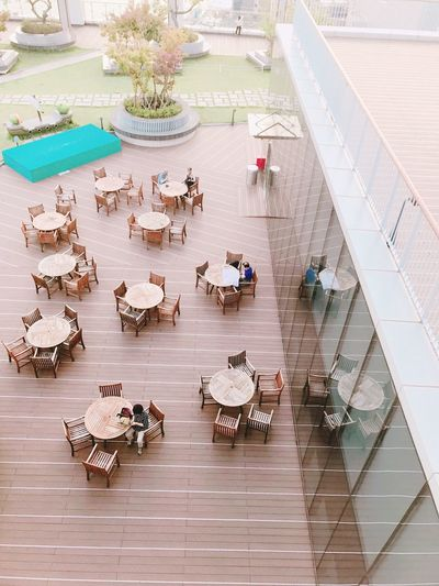 High Angle View Outdoors Cafeteria Tables And Chairs 12F Iphone7photography Busan Lottedepartmentstore Feelfree Sunset ロッテ Day City Mammal 釜山 ロッテ デパートの屋上 暇 釜山日和