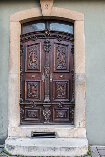 Old door of a historical building with stairway Architecture Built Structure Building Exterior Protection Door Entrance Building Security Closed Day Safety No People Outdoors Wood - Material House Wall - Building Feature Front Door Residential District Old Craft Carving Ornate