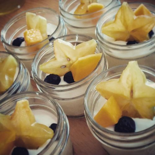 Todays featured treat from Ginasdiner Vanilla and honey greek yogurt topped with fresh starfruit, mango and blueberries in a baby mason jar. Very delicious! Make a bunch ahead of time and add different toppings. Great for quick breakfast, lunch or after dinner.
