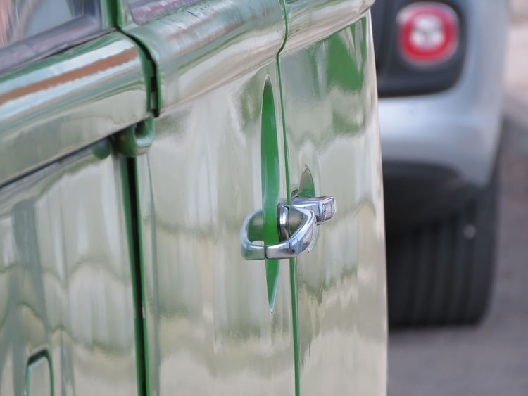 Close-up No People Day Outdoors Metal Reflection Side Door Door Handle Vintage Car Vintage Cars Classic Automobile Classic Car Old Van Check This Out EyeEm Best Shots Eye For Details Focused Selective Focus Detail Part Of Green Color The Drive Tail Light Rear Light Rear Sliding Door