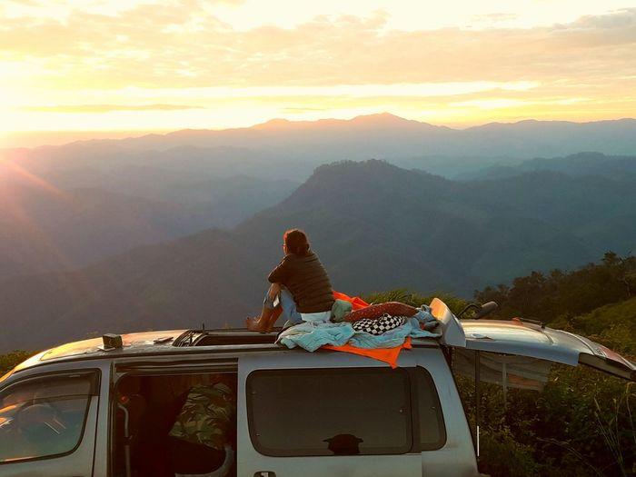 Woman on van looking at view