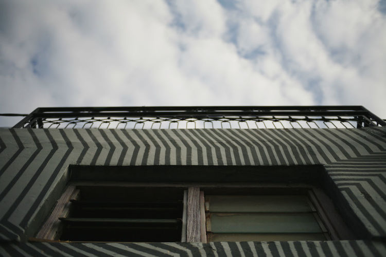 Architecture Cloud - Sky Built Structure Low Angle View Sky Building Exterior Building Roof House No People Nature Day Outdoors Residential District Pattern Window Wood - Material Overcast Sunlight Roof Tile Corrugated