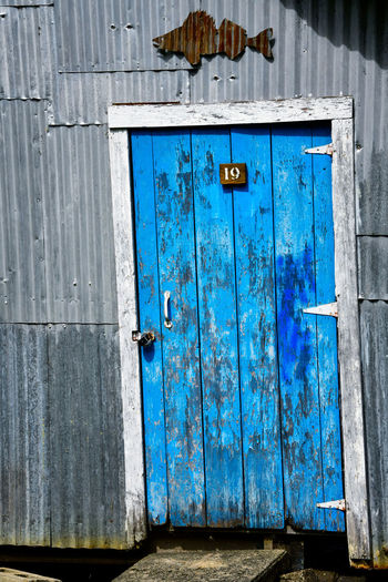 Blue closed door of old building