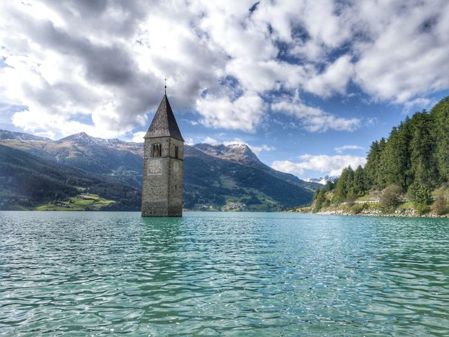 Church Reschensee Südtirol Alps Architecture Beauty In Nature Building Exterior Built Structure Cloud - Sky Day History Lake Mountain Mountain Range Nature No People Outdoors Scenics Sky Steeple Tranquil Scene Tranquility Travel Destinations Water Waterfront