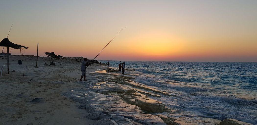 North coast, Alexandria, Egypt Sea Sunset Beach Water Sand Sun Silhouette Sunlight Sky Horizon Over Water Fishing Net Romantic Sky Fishing Fishing Hook