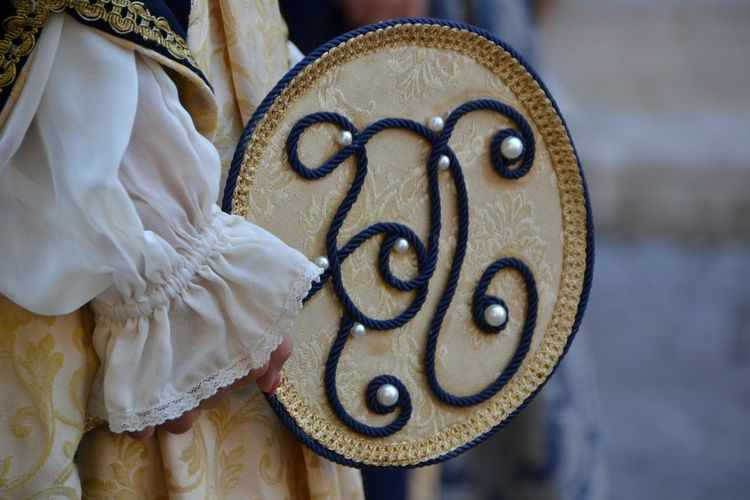 Midsection Of Woman In Traditional Costume With Design Fabric During Corteo Storico Parade