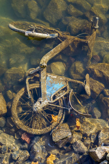 High angle view of abandoned bicycle in sea
