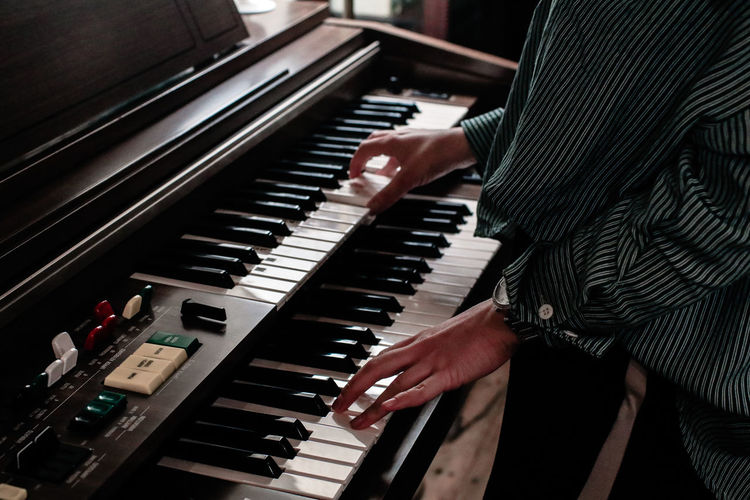 High angle view of man playing piano
