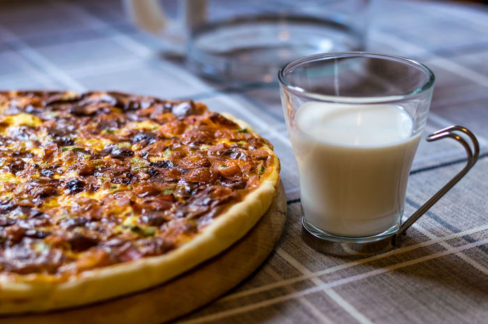 Homemade quiche (tart) with pickles, ham, prosciutto and cheese Beef Cuisine Meal Tart Cheese Drink Drinking Glass Food Food And Drink Italian Meat Pasta Pickles Pizza Prosciutto Quiche Table