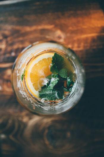 Directly above shot of orange juice in mason jar on table