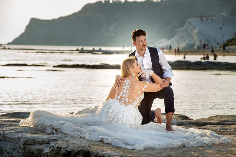 Adult Beach Bride Bridegroom Couple - Relationship Emotion Event Life Events Love Married Men Newlywed Positive Emotion Real People Sea Two People Water Wedding Wedding Dress Wife Women