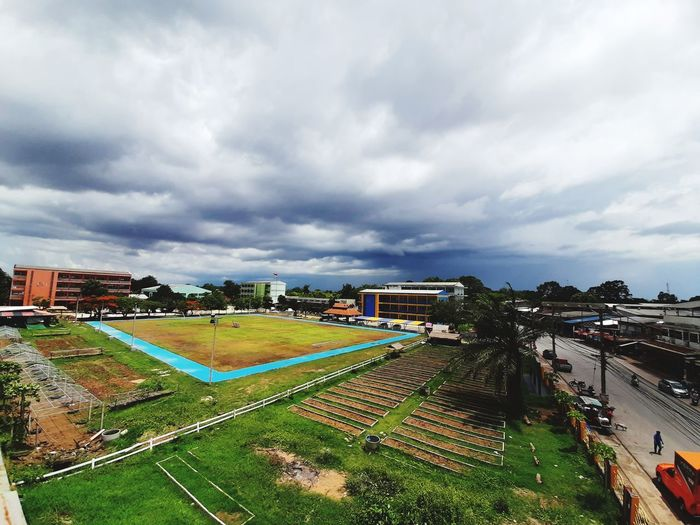 High angle view of soccer field against sky in city