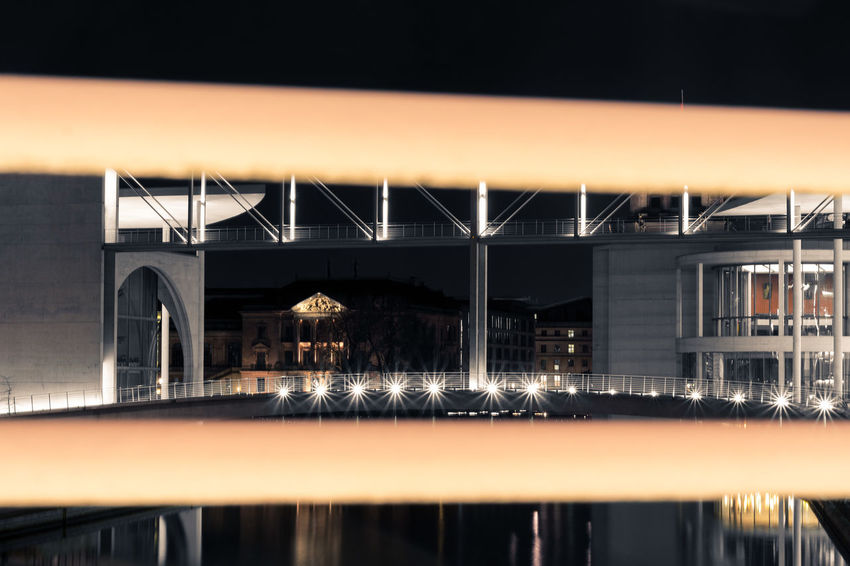 Berlin Paul Löbe Haus The Architect - 2018 EyeEm Awards Arch Arch Bridge Architectural Column Architecture Blurred Motion Bridge Bridge - Man Made Structure Building Exterior Built Structure City Connection Illuminated Long Exposure Motion Nature Night No People Outdoors Railing Reflection Transportation Water