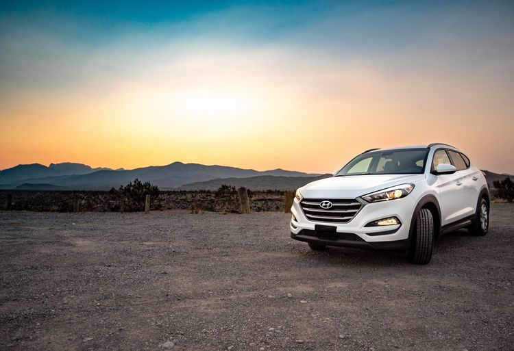 Tuscon Hyundai Mode Of Transportation Car Motor Vehicle Transportation Sky Land Vehicle Nature Scenics - Nature Stationary Environment Outdoors Beauty In Nature Travel Copy Space Sunset Landscape Desert Mountain Road No People
