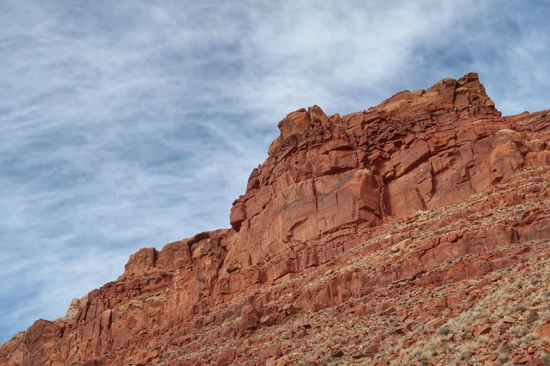 Low angle landscape of red rock mountainside in Arizona Page Arizona Cloud - Sky Sky Low Angle View Rock Rock Formation Rock - Object Nature Physical Geography Geology Tranquil Scene Solid Scenics - Nature Mountain Beauty In Nature No People Travel Day Tranquility Travel Destinations Rocky Mountains
