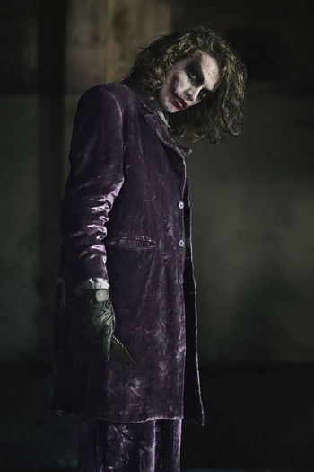 Portrait of man wearing joker costume during halloween