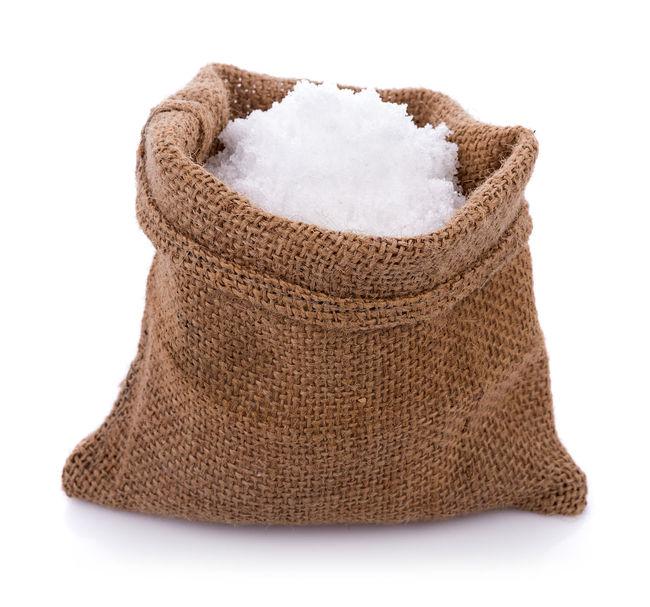 Sea salt in jute sack on white background Salt Close-up Mineral; Salt - Mineral Saltwater Spa White Background White Color